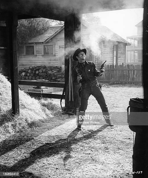 Lee Van Cleef in shootout in a scene from the film 'High Noon', 1952.