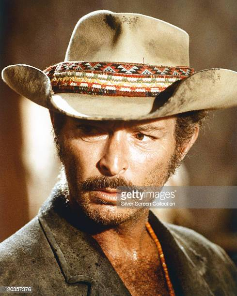 Lee Van Cleef US actor unshaven and wearing a cowboy hat with a multicoloured band in a publicity still issued for an unspecifed film circa 1970