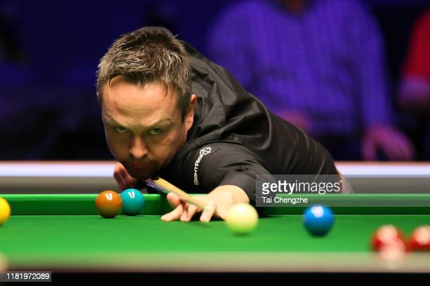 Lee Walker of Wales plays a shot in the quarter-final match against Mark Allen of Northern Ireland on day five of 2019 English Open at K2 Leisure...