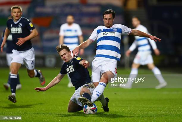 Lee Wallace of Queens Park Rangers and Ben Thompson of Millwall FC battle for the ball during the Sky Bet Championship match between Queens Park...