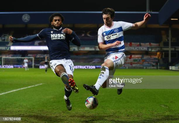 Lee Wallace of Queens Park Rangers and Mahlon Romeo of Millwall FC battle for the ball during the Sky Bet Championship match between Queens Park...