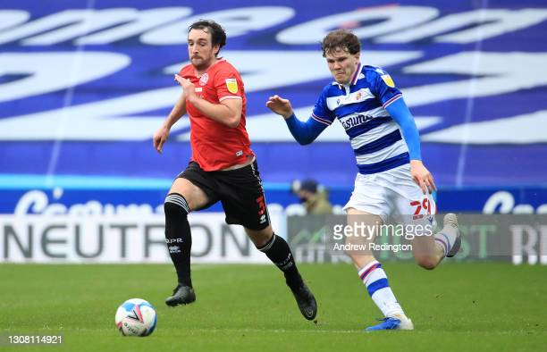 Lee Wallace of Queens Park Rangers is chased by Tom Holmes of Reading FC during the Sky Bet Championship match between Reading and Queens Park...