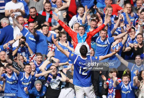 Lee Wallace of Rangers celebrates after scoring his team's third goal during the Scottish Clydesdale Bank Scottish Premier League match between...