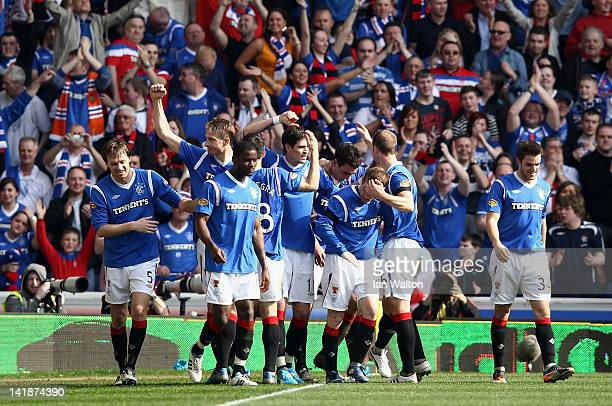 Lee Wallace of Rangers celebrates with teammates after scoring his team's third goal during the Clydesdale Bank Scottish Premier League match between...