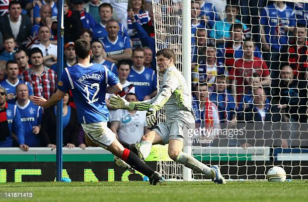 Lee Wallace of Rangers scores his team's third goal during the Clydesdale Bank Scottish Premier League match between Rangers and Celtic at Ibrox...