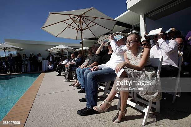 ME–02–06–11 Lee Weinstein and Michael Berman's Goddaughter Lily Morris listenes to speakers during a memorial for Lee The Shiva Sisters are two women...