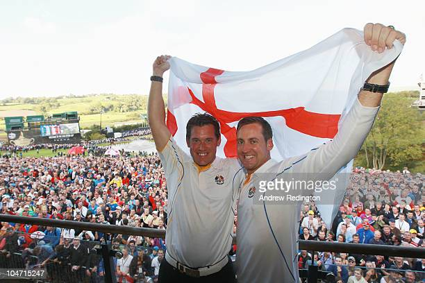 Lee Westwood and Ian Poulter of Europe celebrate on the balcony of the clubhouse following Europe's victory in the 2010 Ryder Cup at the Celtic Manor...