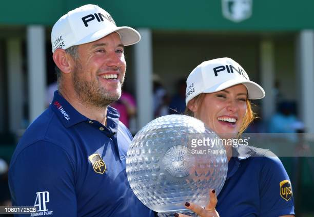 Lee Westwood of England and Caddie and partner Helen Storey pose with the trophy after Lee Westwood wins during Day Four of the Nedbank Golf...