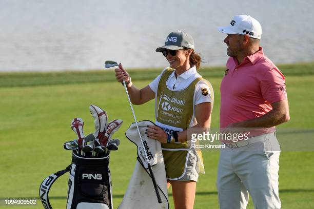Lee Westwood of England and caddie and partner Helen Storey prepare to play a shot on the 17th hole during Day One of the Abu Dhabi HSBC Golf...