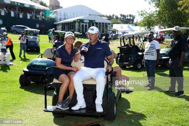 Lee Westwood of England and Caddie and partner Helen Storey sit on the back of a golf buggy after Lee Westwood wins during Day Four of the Nedbank...
