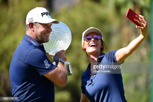 Lee Westwood of England and Caddie and partner Helen Storey take a selfie photograph after Lee Westwood wins during Day Four of the Nedbank Golf...