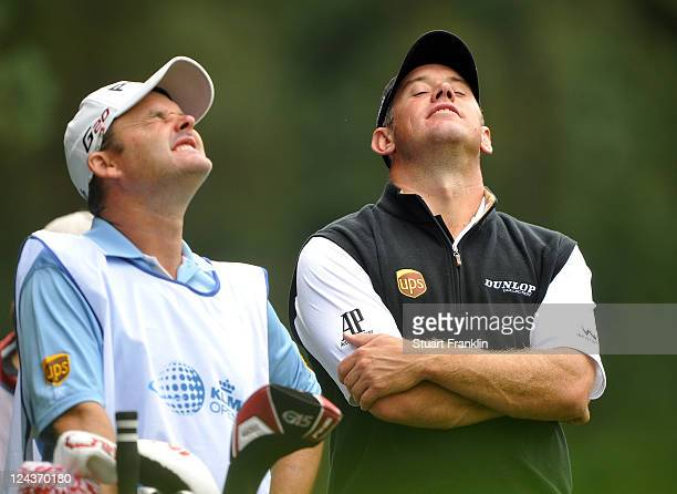Lee Westwood of England and caddie Billy Foster share a joke during the second round of The KLM Open Golf at The Hillversumsche Golf Club on...