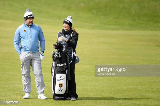 Lee Westwood of England and caddie Helen Storey look on the 17th fairway during Day Two of the Betfred British Masters at Hillside Golf Club on May...