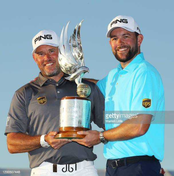 Lee Westwood of England and caddie James Baker pose with the trophy following victory during Day 4 of the Abu Dhabi HSBC Championship at Abu Dhabi...