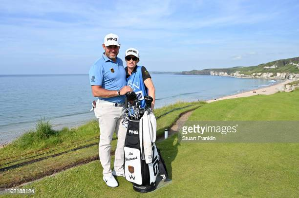 Lee Westwood of England and his caddie and girlfriend Helen Storey during a practice round prior to the 148th Open Championship held on the Dunluce...