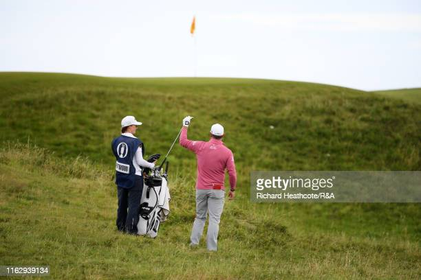 Lee Westwood of England and his caddie and girlfriend Helen Storey prepare a shot during the second round of the 148th Open Championship held on the...