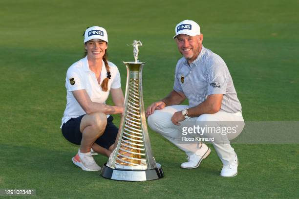 Lee Westwood of England and his caddie and girlfriend Helen Storey celebrate with the Race to Dubai Trophy following Day 4 of the DP World Tour...
