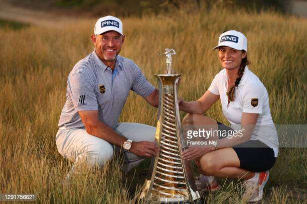 Lee Westwood of England and his caddie and girlfriend Helen Storey celebrate with the Race to Dubai Trophy following Day Four of the DP World Tour...