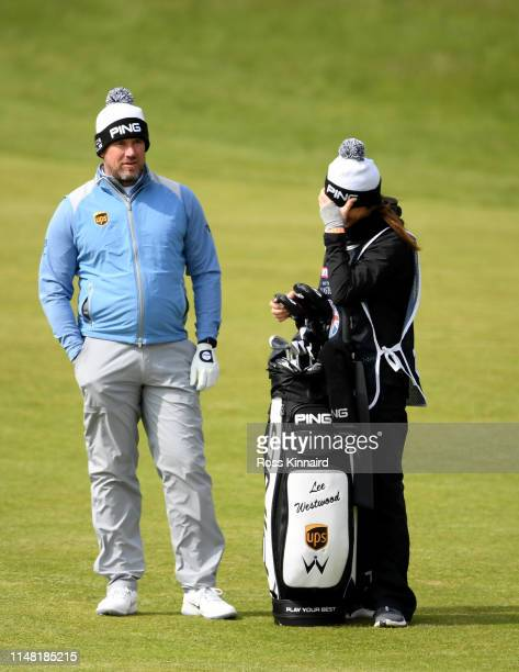 Lee Westwood of England and his caddie / girlfriend Helen Storey on the 17th fairway during the second round of the Betfred British Masters at...