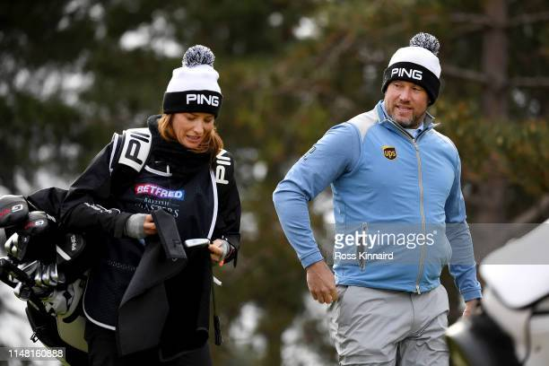 Lee Westwood of England and his caddie Helen Storey look on the 11th tee during Day Two of the Betfred British Masters at Hillside Golf Club on May...