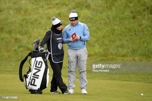 Lee Westwood of England and his caddie Helen Storey on the 14th hole during Day Two of the Betfred British Masters at Hillside Golf Club on May 10...