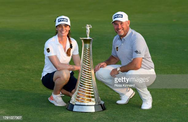 Lee Westwood of England and his girlfriend and caddie, Helen Storey pictured with the Race to Dubai trophy after the final round of the DP World Tour...