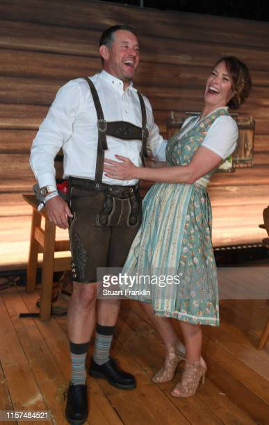 Lee Westwood of England and his partner Helen Storey pose for a picture at the BMW players night day two of the BMW International Open at P1...