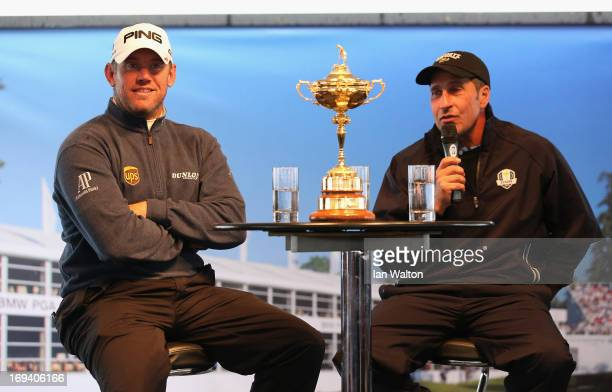 Lee Westwood of England and José María Olazabal of Spain take part in a question and answer session with the public in the tented village during the...