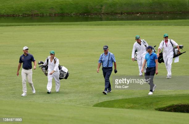 Lee Westwood of England, and Matt Wallace of England walk with Sandy Lyle of Scotland during a practice round prior to the Masters at Augusta...