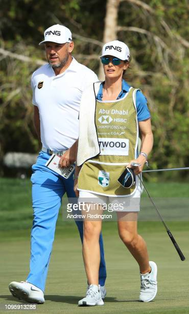 Lee Westwood of England and partner and caddie Helen Storey walk on the 11th hole during Day Three of the Abu Dhabi HSBC Golf Championship at Abu...