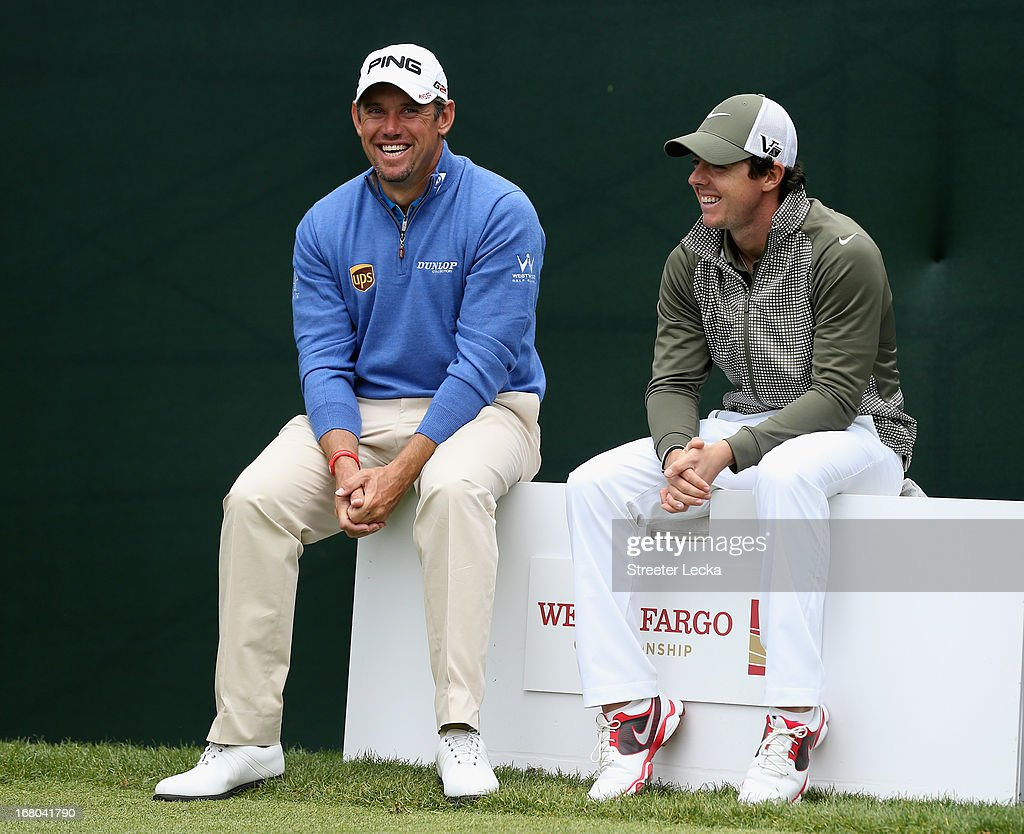 Lee Westwood of England and Rory McIlroy of Northern Ireland wait to hit their tee shots on the 17th hole during the third round of the Wells Fargo Championship at Quail Hollow Club on May 4, 2013 in Charlotte, North Carolina.