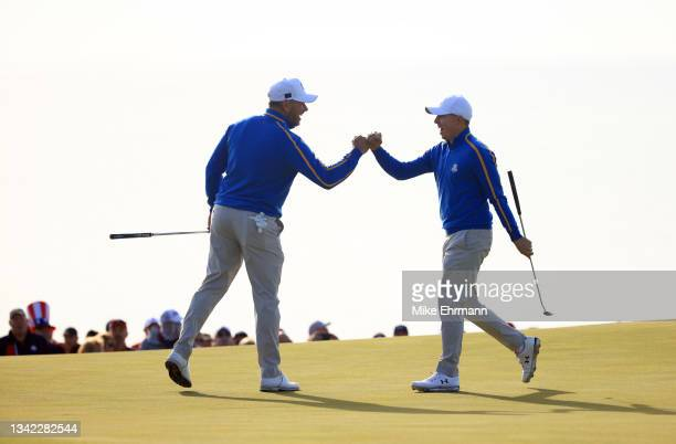 Lee Westwood of England and team Europe and Matthew Fitzpatrick of England and team Europe celebrate during Friday Morning Foursome Matches of the...