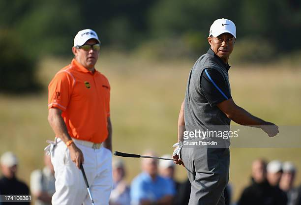 Lee Westwood of England and Tiger Woods of the United States during the third round of the 142nd Open Championship at Muirfield on July 20 2013 in...