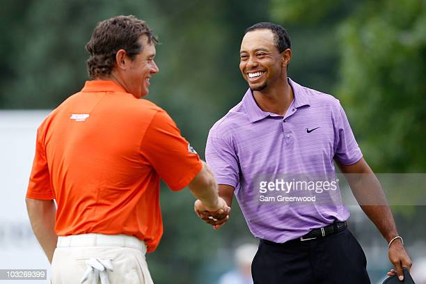 Lee Westwood of England and Tiger Woods shake hands on the ninth hole after finishing the second round of the World Golf Championships - Bridgestone...