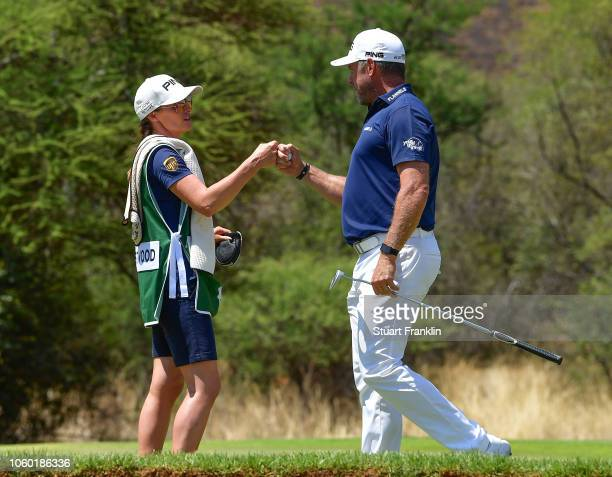 Lee Westwood of England celebrates a birdie with his girlfriend Helen Storey on the 14th hole during the final round of the Nedbank Golf Challenge at...