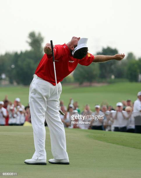 Lee Westwood of England celebrates after winning the Dubai World Championship and The Race to Dubai on the Earth Course Jumeriah Golf Estates on...