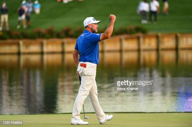 Lee Westwood of England celebrates and pumps his fist after making a birdie putt on the 17th hole green during the third round of THE PLAYERS...