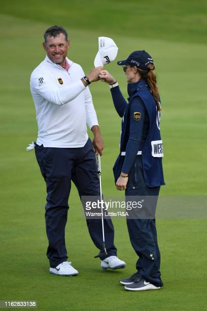 Lee Westwood of England celebrates with caddy and girlfriend Helen Storey on the eighteenth green during the first round of the 148th Open...