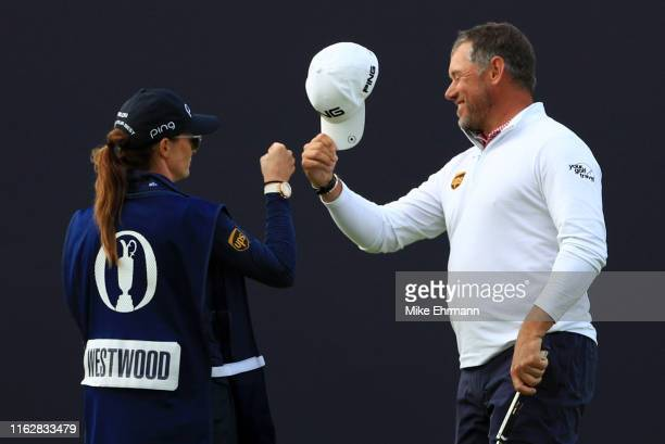Lee Westwood of England celebrates with his caddie Helen Storey on the 18th green during the first round of the 148th Open Championship held on the...