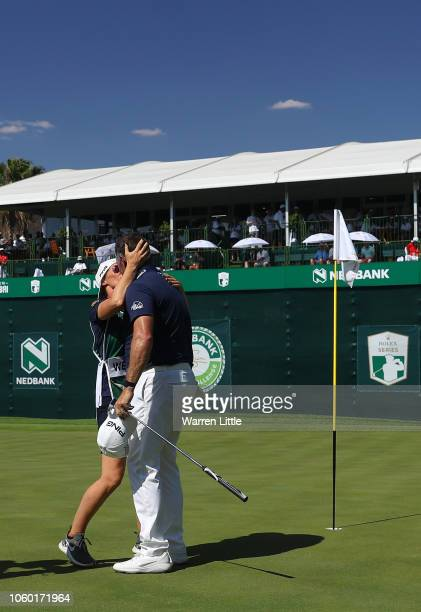 Lee Westwood of England celebrates with partner Helen Storey are he wins the final round during Day Four of the Nedbank Golf Challenge at Gary Player...