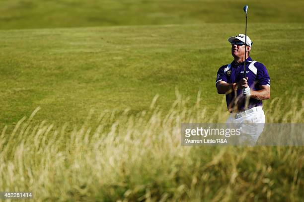 Lee Westwood of England chips to the 11th green during the first round of The 143rd Open Championship at Royal Liverpool on July 17 2014 in Hoylake...