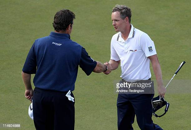 Lee Westwood of England congratulates Luke Donald of England on his victory in a playoff during the final round of the BMW PGA Championship at the...