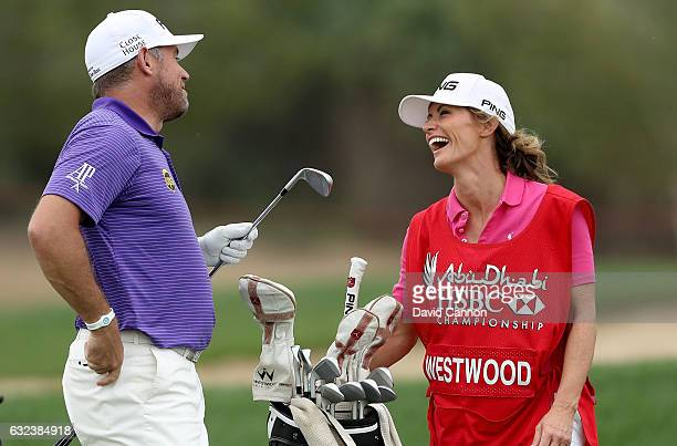 Lee Westwood of England enjoying a moment with his girlfriend Helen Storey who acted as his caddie for the week during the final round of the 2017...