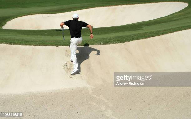 Lee Westwood of England exits the bunker after playing his third shot on the 7th hole during day four of the DP World Tour Championship at Jumeirah...