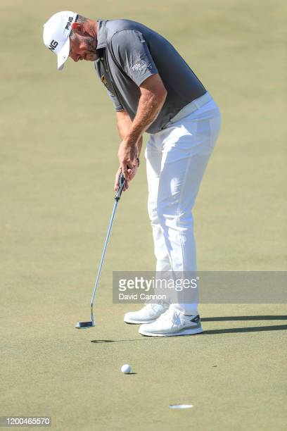 Lee Westwood of England hits a putt on the second hole during the final round of the Abu Dhabi HSBC Championship at Abu Dhabi Golf Club on January 19...