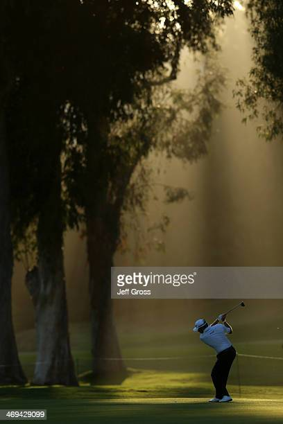 Lee Westwood of England hits a tee shot in the second round of the Northern Trust Open at the Riviera Country Club on February 14, 2014 in Pacific...