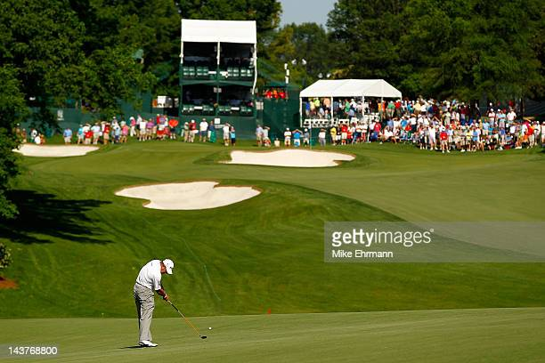 Lee Westwood of England hits an approach shot from the fairway on the 15th hole during the first round of the Wells Fargo Championship at the Quail...