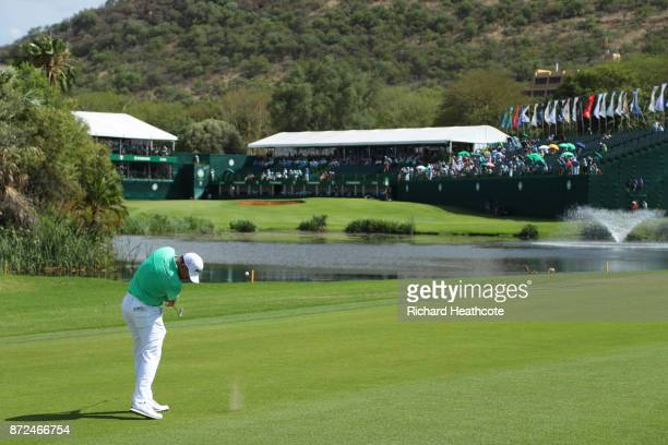 Lee Westwood of England hits an approach shot to the 18th green during the second round of the Nedbank Golf Challenge at Gary Player CC on November...