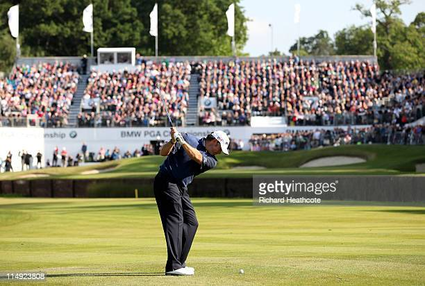 Lee Westwood of England hits his approach shot to the 18th green during the final round of the BMW PGA Championship at the Wentworth Club on May 29,...
