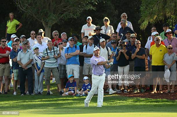 Lee Westwood of England hits his second shot on the 18th hole during day one of the DP World Tour Championship at Jumeirah Golf Estates on November...